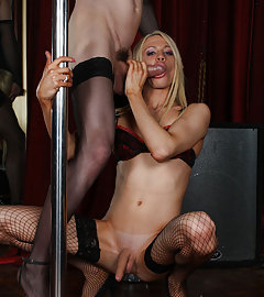 Zoe and Karla Cox get on their knees to perform the art of sucking cock whilst on a lap dance pole