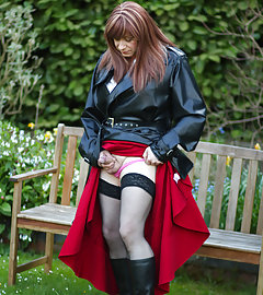 Juicy Luci May wore her lovely long rubber trench coat and a long red skirt, before becoming an all over Domme. How would you like to be kneeling on the grass in front of her ready to tend to all her cock needs