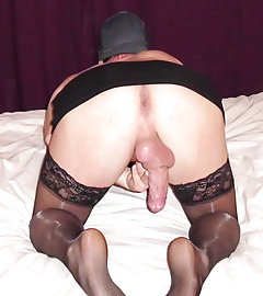 Sexy crossdressers wearing nylons, panties and sexy little skirts, and flashing their cocks
